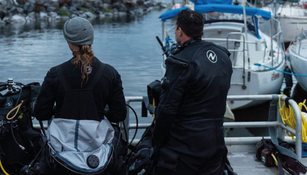 https://thehonestdiver.com/wp-content/uploads/2021/05/Aqua-Lung-Fusion-Sport-Dry-Suit-Boat-Diving.jpg